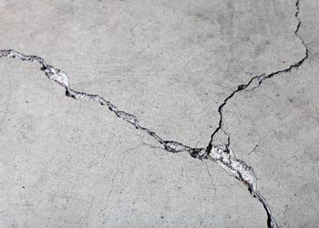 Why It's Better to Remove a Concrete Driveway before Laying Asphalt Grand Rapids Asphalt Paving