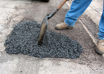 Why Your Parking Lot Needs Pothole Repairs Grand Rapids Asphalt Paving